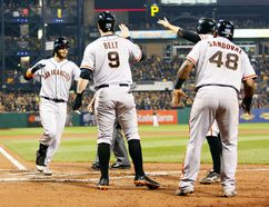 San Francisco Giants shortstop Brandon Crawford (left) celebrates his grand slam against the Pittsburgh Pirates with teammates during the NL wild card game at PNC Park in Pittsburgh, Oct. 1, 2014. (CHARLES LeCLAIRE/USA Today)