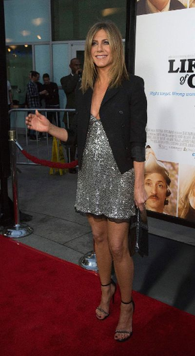"<b>Jennifer Aniston</b> poses at the premiere of ""Life of Crime"" in Los Angeles, California August 27, 2014. The movie opens in the U.S. on August 29. (REUTERS/Mario Anzuoni)<div id=""pd_rating_holder_7859029""></div> <script type=""text/javascript""> PDRTJS_settings_7859029 = { ""id"" : ""7859029"", ""unique_id"" : ""default"", ""title"" : """", ""permalink"" : """" }; (function(d,c,j){if(!document.getElementById(j)){var pd=d.createElement(c),s;pd.id=j;pd.src=('https:'==document.location.protocol)?'https://polldaddy.com/js/rating/rating.js':'http://i0.poll.fm/js/rating/rating.js';s=document.getElementsByTagName(c)[0];s.parentNode.insertBefore(pd,s);}}(document,'script','pd-rating-js')); </script>"