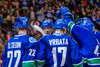Vancouver Canucks forward Daniel Sedin (22), and  forward Henrik Sedin (33), and forward Radim Vrbata (17)  celebrate Vrbata's goal during the third period of a preseason game at Rogers Arena. (Bob Frid-USA TODAY Sports)