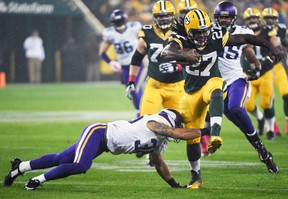 Green Bay Packers running back Eddie Lacy breaks a tackle by Minnesota Vikings safety Robert Blanton at Lambeau Field in Green Bay, Oct. 2, 2014. (BENNY SIEU/USA Today)