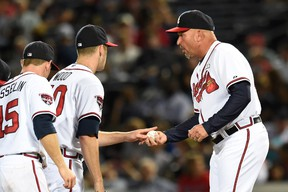 Atlanta Braves manager Fredi Gonzalez (33) takes the ball from starting pitcher Alex Wood (40) to  change pitchers against the Washington Nationals during the seventh inning at Turner Field on Sep 17, 2014 in Atlanta, GA, USA. (Dale Zanine/USA TODAY Sports)