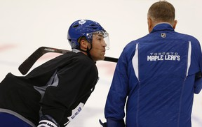 Defenceman Stephane Robidas listens intently as coach Randy Carlyle gets his point across during Friday's morning skate at the ACC. Robidas, coming off a broken leg last season, made his Leafs debut in Friday's exhibition game against Detroit. CRAIG ROBERTSON/TORONTO SUN)