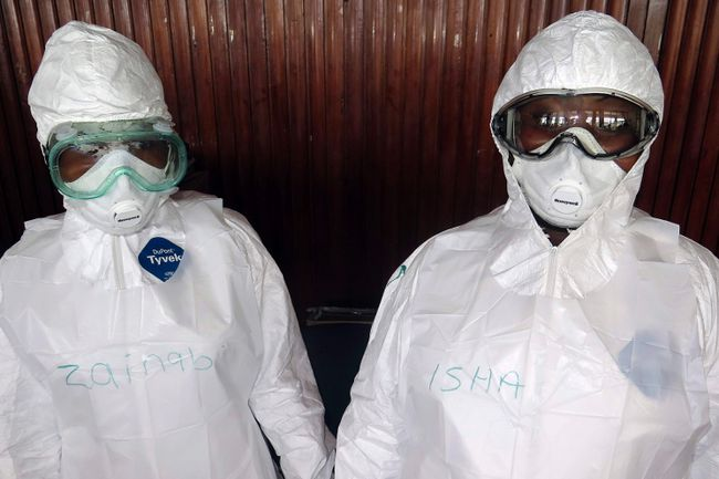 The names of trainee health workers are seen written on their protective suits at a World Health Organization (WHO) training session in Freetown, Sierra Leone, September 30, 2014.  REUTERS/Umaru Fofana
