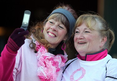 """Terry Firth (l) and Linda Lagace take a """"selfie"""" during the CIBC Run for the Cure in Winnipeg, Man. Sunday October 05, 2014. Brian Donogh/Winnipeg Sun/QMI Agency"""
