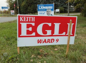 Ward 9 councillor Keith Egli's election sign is seen along with challenger Cristian Lambiri in the Knowdale-Merivale Ward on Tuesday Sept 30,  2014.  Tony Caldwell/Ottawa Sun/QMI Agency