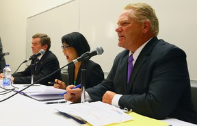 John Tory, Olivia Chow and Doug Ford during a debate at Centennial College in Toronto on Monday, October 6, 2014. (Dave Abel/Toronto Sun)