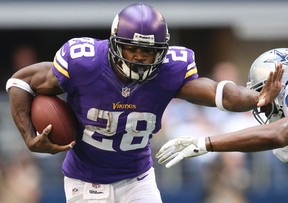 Minnesota Vikings Adrian Peterson runs with ball against the Dallas Cowboys in the first quarter at AT&T Stadium in Arlington, Texas in this file photo taken November 3, 2013. (REUTERS)