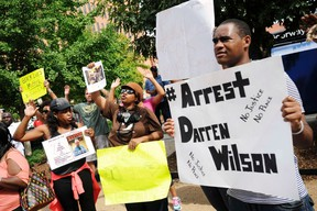 Protestors at the St. Louis County Justice Center call for the arrest of Police Officer Darren Wilson in Clayton, Missouri in this August 20, 2014 file photo. (REUTERS/Mark Kauzlarich)