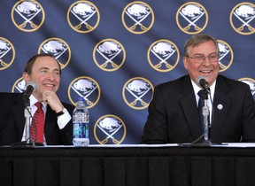 NHL Commissioner Gary Bettman laughs with Buffalo Sabres owner Terry Pegula during a news conference announcing new ownership on February 22, 2011. (REUTERS/Gary Wiepert)