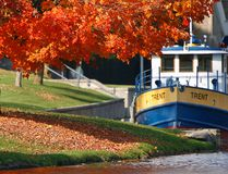 The Trent Severn tug boat is anchored next to colourful fall foliage below the Peterborough Lift Lock. Clifford Skarstedt/QMI Agency