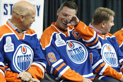 (Left to right) Mark Messier, Wayne Gretzky and Jari Kurri share a laugh during an Edmonton Oilers media availability with the members of the Stanley Cup winning 83-84 Oilers at Rexall Place in Edmonton, Alta., on Wednesday, Oct. 8, 2014. Players and coaches spoke about the historic win against the New York Islanders, reminisced about the past and had a group photo taken. The 84 reunion event is set for Oct. 10, 2014. Ian Kucerak/Edmonton Sun/ QMI Agency