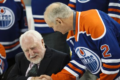 Former Oilers defenceman Lee Fogolin (right) shakes hands with former owner Peter Pocklington during an Edmonton Oilers media availability with the members of the Stanley Cup winning 83-84 Oilers at Rexall Place in Edmonton, Alta., on Wednesday, Oct. 8, 2014. Players and coaches spoke about the historic win against the New York Islanders, reminisced about the past and had a group photo taken. The 84 reunion event is set for Oct. 10, 2014. Ian Kucerak/Edmonton Sun/ QMI Agency