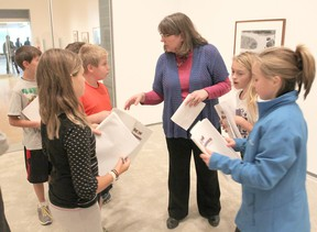Linda Lamoureux, volunteer co-ordinator for the Beyond Classrooms program, talks to students about their journals as they spend a week in the Agnes Etherington Art Centre. (Michael Lea/The Whig-Standard)