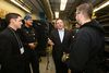 Minister of Employment and Social Development and Minister for Multiculturalism Jason Kenney, second from right, speaks with students and staff during a tour of the Edmonton Catholic School District's High School to Hard Hats program at St. Joseph High School in Edmonton, Alta., on Thursday, Oct. 9, 2014. Codie McLachlan/Edmonton Sun