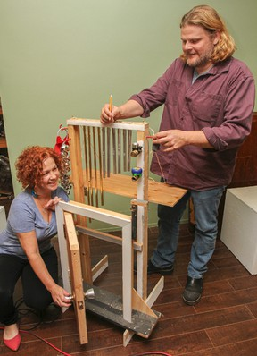 Krista and Clayton Garrett with their homemade sound effects machine at the King's Town Players rehearsal space on  October 8. (JULIA MCKAY/The Whig-Standard)