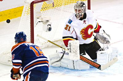 Edmonton's Teddy Purcell (16) can't get past Calgary's goalie Karri Ramo (31) during the second period of the Edmonton Oilers' NHL hockey game against the Calgary Flames at Rexall Place in Edmonton, Alta., on Thursday, Oct. 9, 2014. Codie McLachlan/Edmonton Sun/QMI Agency