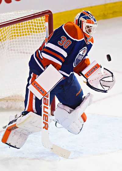 Edmonton's goalie Ben Scrivens (30) leaves the ice to make a save during the third period of the Edmonton Oilers' NHL hockey game against the Calgary Flames at Rexall Place in Edmonton, Alta., on Thursday, Oct. 9, 2014. The Flames won 5-2. Codie McLachlan/Edmonton Sun/QMI Agency
