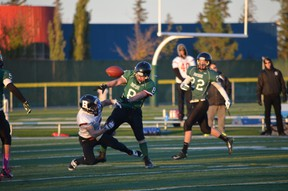 Wyatt Shorey breaks up a pass downfield against Bellarose on Oct. 2, deflecting the ball right into the hands of Logan Sadowsky for a momentum-changing interception. - Thomas Miller, Reporter/Examiner