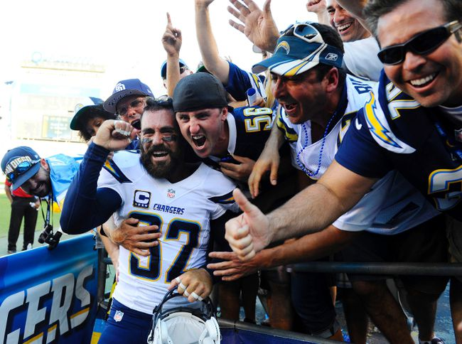 San Diego Chargers safety Eric Weddle (32) celebrates with fans following a win against the Dallas Cowboys at Qualcomm Stadium on Sep 29, 2013 in San Diego, CA, USA. ( Christopher Hanewinckel/USA TODAY Sports)