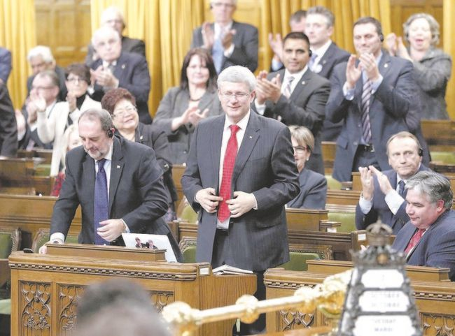 Prime Minister Stephen Harper stands to vote in favour of a government motion to participate in U.S.-led air strikes against Islamic State militants operating in Iraq, in the House of Commons on Parliament Hill in Ottawa this week. (Chris Wattie/Reuters)