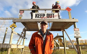 Vince Rattai of Deer Meadow Farms north of Winnipeg, along with helpers Sloan Reimer (left) and James Hayes, stand at the zombie gate, part of their forbidden forest.