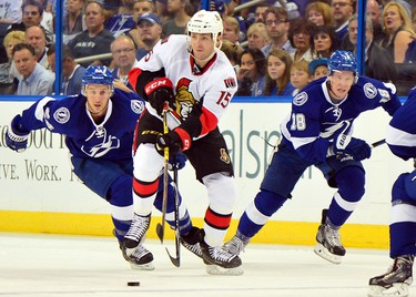 Oct 11, 2014; Tampa, FL, USA; Ottawa Senators center Zack Smith (15) passes the puck as Tampa Bay Lightning right wing Ryan Callahan (24) defends during the first period at Tampa Bay Times Forum. Mandatory Credit: Steve Mitchell-USA TODAY Sports