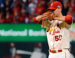 St. Louis Cardinals starting pitcher Adam Wainwright prepares to throw against the San Francisco Giants in Game 1 of the National League Championship Series at Busch Stadium in St. Louis, Oct. 11, 2014. (JEFF CURRY/USA Today)