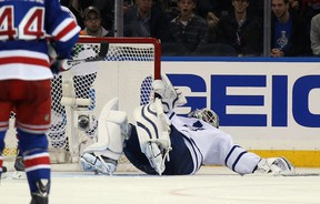 Maple Leafs goaltender James Reimer is injured in the third period against the New York Rangers in New York City on Sunday night. Reimer left the game. (AFP/PHOTO)