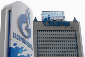 A general view shows the headquarters of Gazprom, with a board of Gazprom Neft, the oil arm of Gazprom seen in the foreground, on the day of the annual general meeting of the company's shareholders in Moscow, June 27, 2014. (REUTERS/Sergei Karpukhin)
