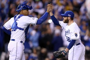 Greg Holland of the Kansas City Royals celebrates with catcher Salvador Perez after closing out the ninth inning to defeat the Baltimore Orioles in Game 3 of the ALCS at Kauffman Stadium on October 14, 2014. (Ed Zurga/Getty Images/AFP)