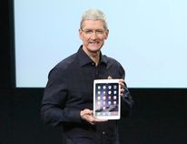 Apple CEO Tim Cook holds an iPad during a presentation at Apple headquarters in Cupertino, Calif., Oct. 16, 2014. REUTERS/Robert Galbraith
