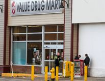 Police search for suspicious packages outside of the Value Drug Mart in downtown Wetaskiwin on Oct. 16. RCMP cordoned off three downtown blocks after a bomb threat was called into the store.