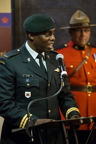 Capt. Christopher Stobbs, with 3rd Canadian Division Support Group, speaks during a citizenship ceremony held at Rexall Place in Edmonton, Alta., on Friday, Oct. 17, 2014. The Edmonton Oilers hosted event, which saw 12 people become Canadian, is part of the celebrations of Canada's Citizenship Week 2014, which runs from Oct. 13-19. Ian Kucerak/Edmonton Sun/ QMI Agency