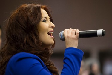 Edmonton Oilers anthem singer Caroline Ryan sings Oh Canada during a citizenship ceremony held at Rexall Place in Edmonton, Alta., on Friday, Oct. 17, 2014. The Edmonton Oilers hosted event, which saw 12 people become Canadian, is part of the celebrations of Canada's Citizenship Week 2014, which runs from Oct. 13-19. Ian Kucerak/Edmonton Sun/ QMI Agency