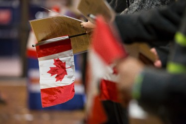 Canadian flags are seen during a citizenship ceremony held at Rexall Place in Edmonton, Alta., on Friday, Oct. 17, 2014. The Edmonton Oilers hosted event, which saw 12 people become Canadian, is part of the celebrations of Canada's Citizenship Week 2014, which runs from Oct. 13-19. Ian Kucerak/Edmonton Sun/ QMI Agency