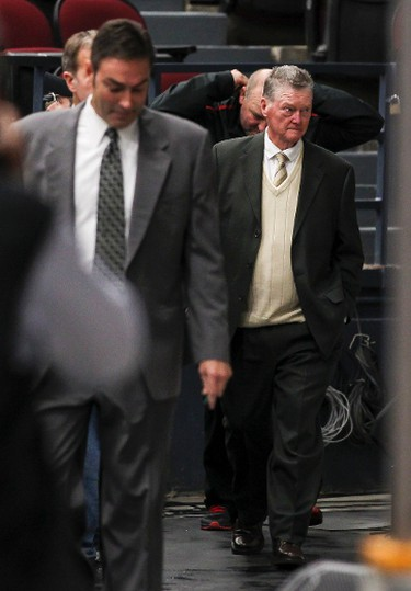 Hockey Hall of Fame coach Brian Kilrea (R) walks with Ottawa 67's head coach Jeff Brown towards the bench on Friday October 17, 2014. The 67's signed Kilrea to a one day contract so he could coach to celebrate his 80th birthday. Errol McGihon/Ottawa Sun/QMI Agency