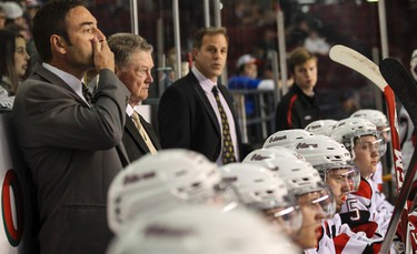 Hockey Hall of Fame coach Brian Kilrea with current Ottawa 67's head coach Jeff Brown (L) and assistant coach Mike Eastwood (R) behind the bench on Friday October 17, 2014. The 67's signed Kilrea to a one day contract so he could coach to celebrate his 80th birthday. Errol McGihon/Ottawa Sun/QMI Agency