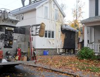 An early-morning garage fire on James Street has displaced people from two homes (ALANAH DUFFY/The Recorder and Times).