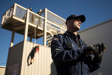 Edmonton Fire Rescue Services Capt. Ed Pitman explains the ins and outs of a rescue from heights during an EFRS training school open house in Edmonton, Alta., on Saturday, Oct. 18, 2014. Approximately 250 firefighter hopefuls showed up to learn about firefighting with Edmonton's firefighters. Ian Kucerak/Edmonton Sun/ QMI Agency