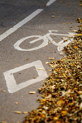 Now you see them, now you don't? A bike lane sign is seen on 106 Street southbound at 70 Avenue in Edmonton, Alta., on Saturday, Oct. 11, 2014. City council is now reconsidering how bike lanes are picked and constructed around the city. Ian Kucerak/Edmonton Sun/ QMI Agency