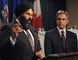 Alberta Premier Jim Prentice (R) watches as Minister of Infrastructure Manmeet Bhullar  explains details on how the government will start on a three-phase build-out consisting of 230 capital projects consisting of both new schools and modernizations throughout Alberta.