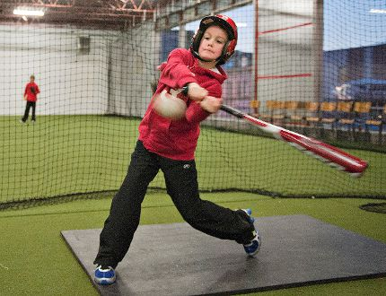 An Expositor file photo shows Reece Eberley practising his swing last year at the Brantford Minor Baseball Association's indoor training facility in the former Union Gas building on Colborne Street. The association is looking for a new home for the facility after learning that the Union Gas building will be torn down. (Brian Thompson, The Expositor)