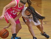 Isabella Mitchell (right) of the Pauline Johnson Thunderbirds tries to regain possession of the ball from Jen Garner of the St. John's Eagles during a high school senior girls basketball game. (BRIAN THOMPSON, The Expositor)
