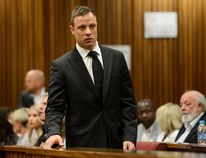 South African Olympic and Paralympic track star Oscar Pistorius attends his sentencing at the North Gauteng High Court in Pretoria on October 21, 2014. (REUTERS/Herman Verwey/Pool)