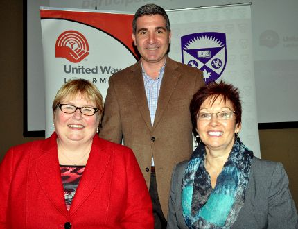 Andrew Lockie, CEO of United Way London and Middlesex (middle) is flanked by Western University's Margaret Steele (left) and Peggy Wakabayashi, co-chairs of Western's 2014 United Way Campaign, October 21, 2014. CHRIS MONTANINI\LONDONER\QMI AGENCY