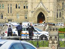 Police have locked down Parliament Hill in Ottawa on Wednesday, Oct. 22, 2014, where a shooting occurred. (MATTHEW USHERWOOD/ QMI Agency)