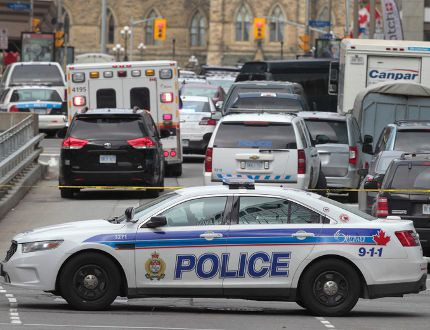 Police patrol near Parliament Hill in Ottawa on Wednesday Oct. 22, 2014. An arrest has been made after at least one person was shot in a hail of gunfire on Parliament Hill and the nearby cenotaph.