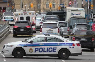 Police patrol near Parliament Hill in Ottawa on Wednesday Oct. 22, 2014. An arrest has been made after at least one person was shot in a hail of gunfire on Parliament Hill and the nearby cenotaph. Tony Caldwell/Ottawa Sun/QMI Agency