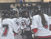 Members of the Central Plains Capitals Female AAA Midget team celebrate a goal during the Caps win over Norman Oct. 5. (Kevin Hirschfield/The Graphic)