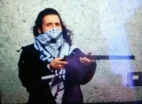 Michael Zehaf-Bibeau, pictured in this image tweeted from an ISIS social media account, has been identified as the shooter of a soldier standing guard at the National War Memorial in Ottawa, Oct. 22, 2014. (Twitter/Handout/QMI Agency)
